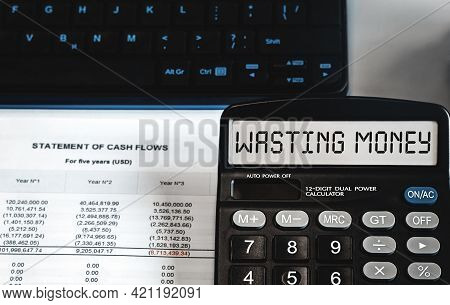 Wasting Money - Concept Of Text On Calculator Display. Business, Tax And Financial Concept