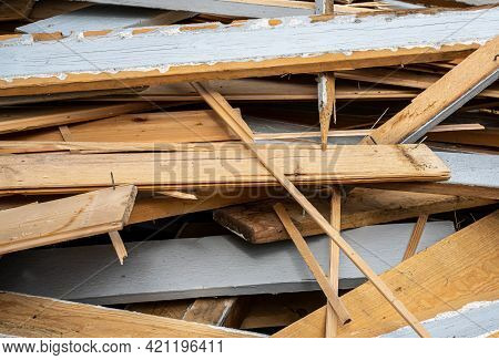 Pile Of Old Wooden Planks In A Heap After A House Is Demolished.