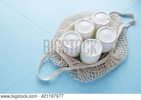Homemade Crockpot Greek Yogurt In Glass Jars On Light Blue Background.