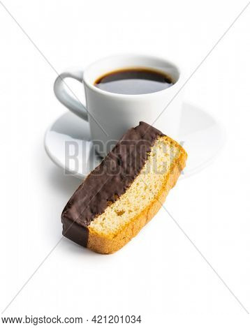 Sliced sponge dessert. Sweet sponge cake with chocolate and coffee cup isolated on white background.