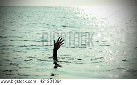 Dramatic Scene With The Open Hand Of The Unfortunate Castaway Who Is About To Drown In The Sea With