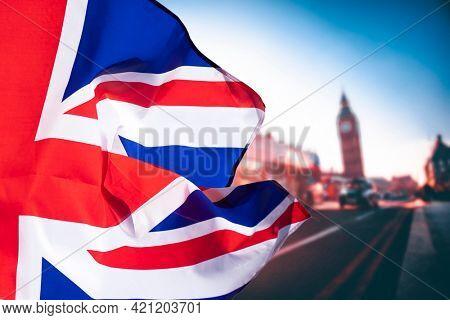 Union Jack flag and iconic London landmarks in the background