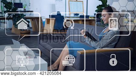 Composition of network of speech bubbles with icons over woman using tablet. global internet of things connections, business, networking and digital interface concept digitally generated image.
