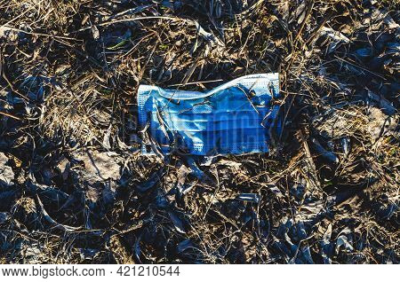 Improper Disposal Of Used Face Mask, Discarded Mask Concept Corona Virus, Covid-19. Discarded Medica