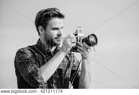 Guy Outdoors Blue Sky Background. Photojournalist Concept. Travel Blogger. Reporter Taking Photo. Vi