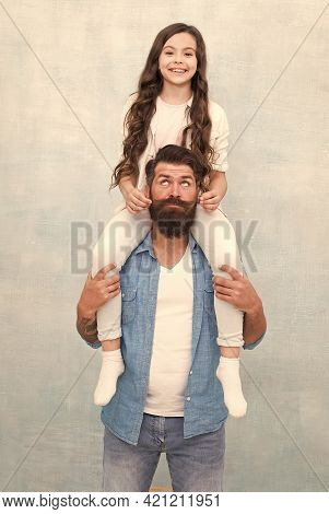 Growing Mustache Is Fun. Little Daughter Twist Fathers Moustache. Happy Family Grey Background. Bear