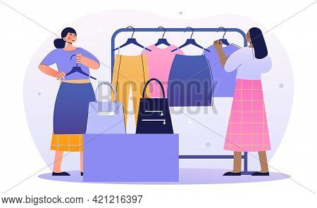 Two Female Merchandisers Are Working In A Shop Together. Concept Of Professional Showcase Designer M