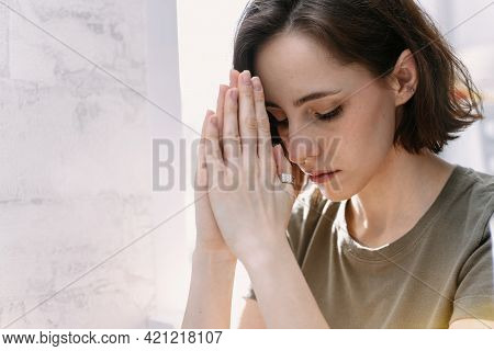 Cute Beautiful Girl Folded Her Hands In Prayer. A Woman Asks God For Help