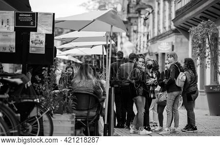 Strasbourg, France - May 19, 2021: Happy Group Of Girls Waiting To Be Seated At Terrace Of Academie