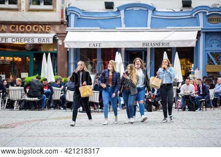 Strasbourg, France - May 19, 2021: Group Of Young Girls With People Drinking At The Terraces In The