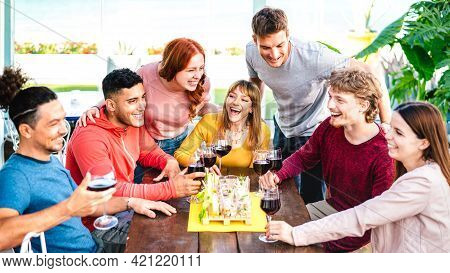 Happy Friends Having Fun Together Drinking Wine At Rooftop  On Private House Party - Young People Ea