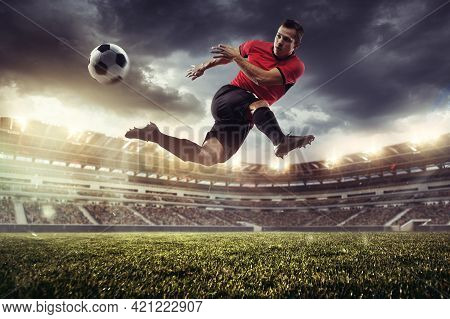Professional Male Football, Soccer Player On Stadium Background. Caucasian Fit Athlete Practicing, P