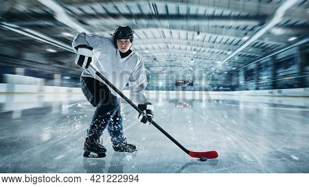 Professional Male Hockey Player On Ice Court Background. Caucasian Fit Athlete Practicing, Training
