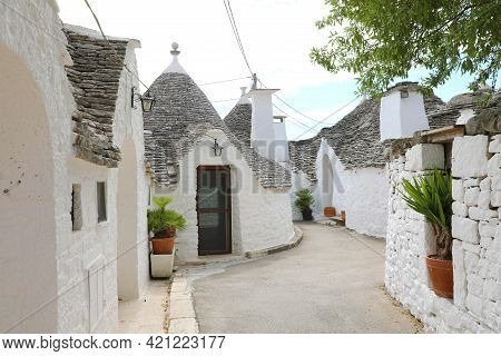 Alberobello Village With Traditional Dry Stone Hut With A Conical Roof In Apulia, Italy