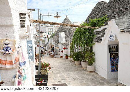 Alberobello, Italy - July 17, 2020: The Village Of Alberobello With Souvenir Shops In Trulli Houses,