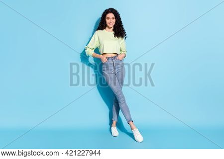 Photo Of Confident Charming Lady White Smile Look Camera Wear Pullover Jeans Footwear Isolated Blue