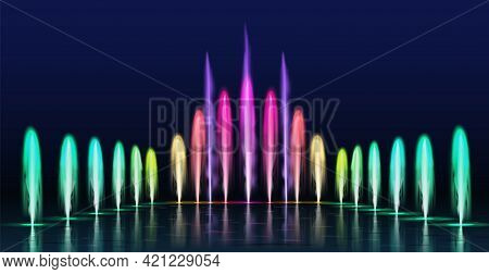 Fountains Show. Realistic Colored Dancing Water Jets In Night. Fountain Cascade With Lights For Park