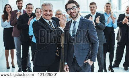 Project Manager Congratulating The Best Employee On The Victory