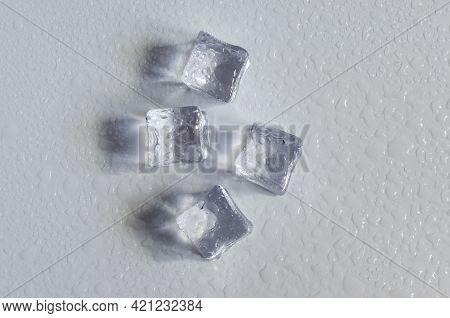 Transparent Artificial Ice Cubes On A Light Background Close-up. Background Of Transparent Ice Cubes