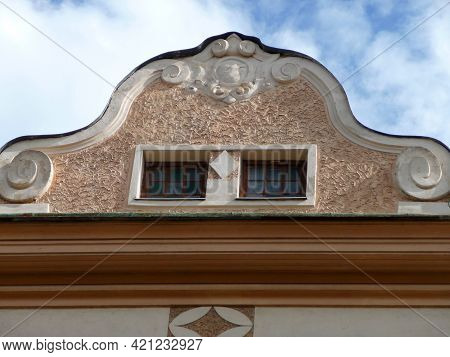 A Gable With A Window And Plastering.