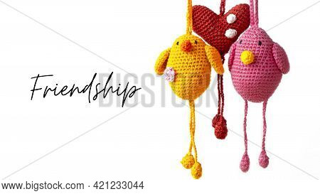 Two Amigurumi Birds Flying Together With A Heart In The Middle With Illustrative Text. Concept Of Te