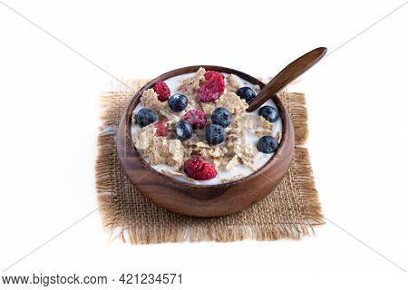 Rice  And Wholewheat Cereal Flakes With Dried And Fresh Berries Isolated On White