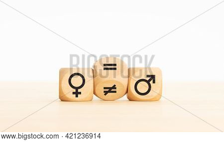 Gender Equality Concept. Wooden Block Turning A Unequal Sign To A Equal Sign Between Symbols Of Men