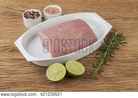 Raw Pork Loin Meat Over Wooden Board With Seasonings.