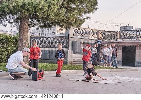 Yekaterinburg, Russia - May 15, 2021: Boys Are Dancing Breakdance On A City Street. The Soloist Chil