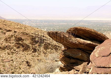 Eroded Rocks And Boulders On A Mountain Ridge Overlooking The Coachella Valley Including The City Of