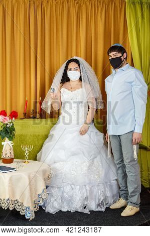 During The Chuppah Ceremony At A Jewish Wedding In The Synagogue, The Bride And Groom Stand Next To
