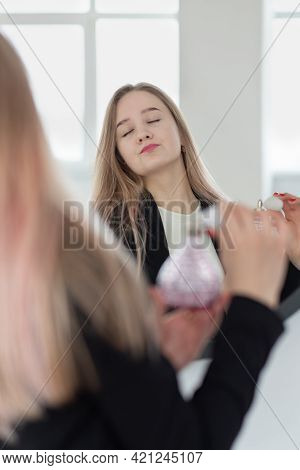 Partially Blurred, Selective Focus, Young Caucasian Blond Woman Hold Bottle Of Perfume Or Eau De Toi