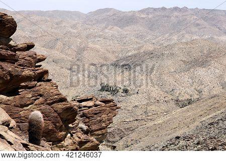 Arid Mountain Cliffs Covered With Barrel Cactus Overlooking Barren Hills On Rural Badlands Taken At