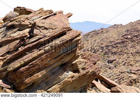 Eroded Rocks And Boulders On An Arid Hillside Surrounding A Rural Gorge Taken At The Colorado Desert