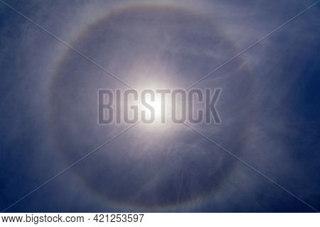 Fantastic Beautiful Sun Halo Phenomenon In The Blue Sky. Rainbow In The Form Of A Circle Around The