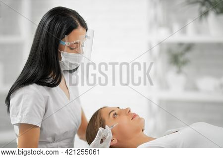 Side View Of Beautiful Beautician In Protective Mask Doing Injection Tighten Skin From Wrinkles In P
