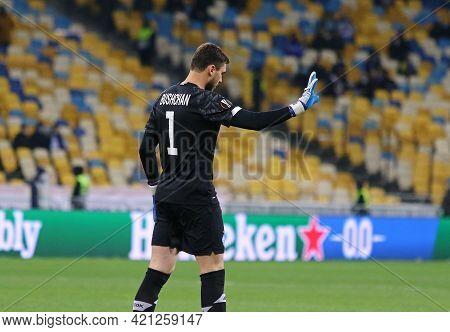 Kyiv, Ukraine - March 11, 2021: Goalkeeper Georgiy Bushchan Of Dynamo Kyiv In Action During The Uefa