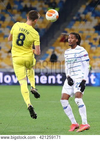 Kyiv, Ukraine - March 11, 2021: Juan Foyth Of Villarreal (l) Fights For A Ball With Gerson Rodrigues