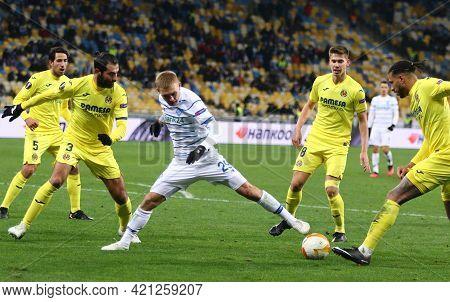 Kyiv, Ukraine - March 11, 2021: Vitaliy Buyalskiy Of Dynamo Kyiv (in White) Fights For A Ball With V
