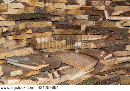 Dry Chopped Firewood In A Bunch. Stack Of Firewood For Kindling