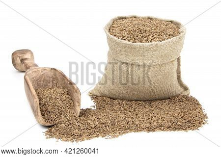 Seeds Of Cumin In A Sack Isolated On A White Background. Caraway Seeds. Caraway In A Burlap Sack. He