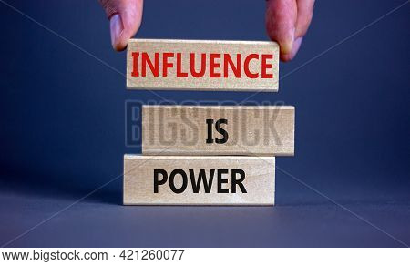 Influence Is Power Symbol. Wooden Blocks With Words 'influence Is Power'. Beautiful Grey Background,