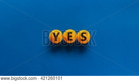 Yes Choice Symbol. Orange Table Tennis Balls With The Word 'yes'. Beautiful Blue Background. Busines