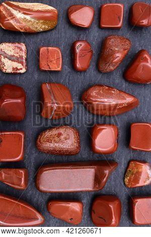 Red Jasper Rare Jewel Stones Texture On Black Stone Background