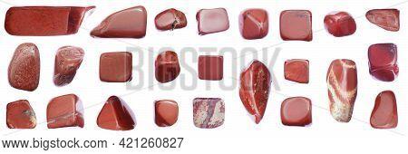 Red Jasper Jewel Stones Set Texture On Light White Isolated Background. Macro Closeup.