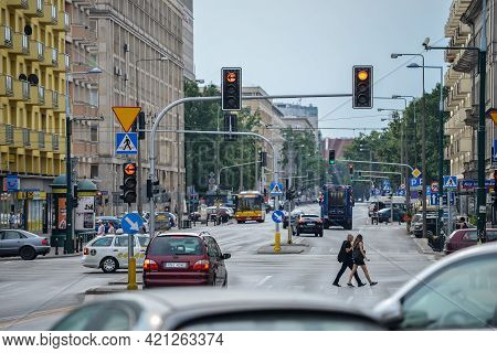 Warsaw. Poland - August 2015: Road In The City, City Traffic, Traffic Lights, Yellow Traffic Light I