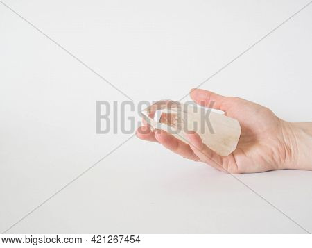 Beautiful Clear Quartz Tower In Woman Hand. Quartz Crystal, Healing Crystal Being Held In Hand. Vibr