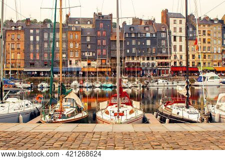 Honfleur, France - October 14, 2017: Colorful Cityscape With Sailboats And Old Houses In Harbour