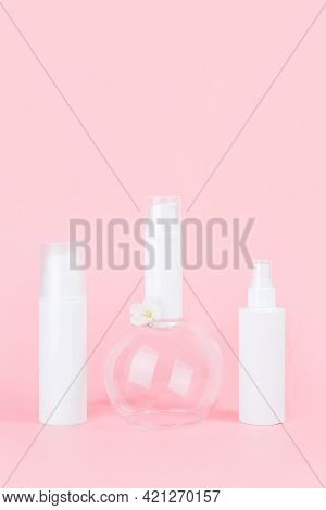 Set Of Care Cosmetic For Skin, Face, Body Or Hair. White Blank Cosmetics Bottles And Tube On Glass P