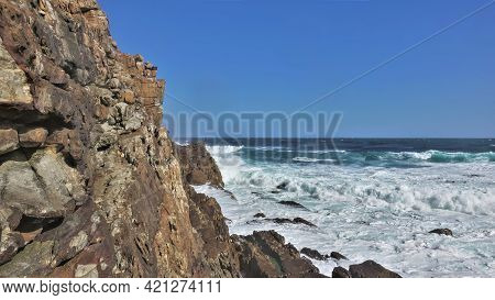 The Turquoise Waves Of The Atlantic Ocean Beat Against The Sheer Cliffs Of The Cape Of Good Hope. Th